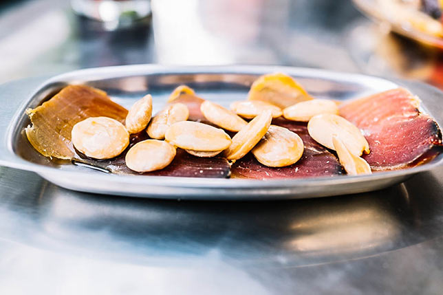 We don't take you to tapas bars but to local spots in Bacelona